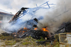 Farm house burns down by fire Stock Photo