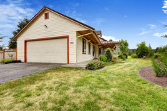 Farm house exterior. Garage with driveway Stock Image
