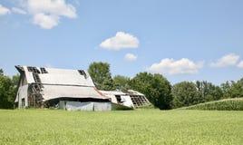 Farm House in a field of Green Grass stock photos
