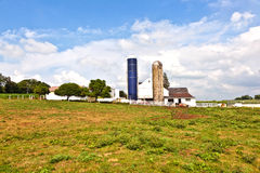 Farm house with field and silo Royalty Free Stock Photo
