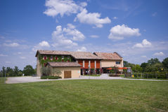 The farm house with green grass Royalty Free Stock Image