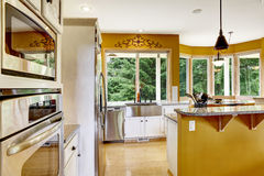 Farm house interior. Kitchen room in bright yellow color. Royalty Free Stock Images
