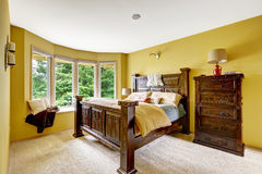 Farm house interior. Luxury bedroom interior with rich wooden fu Stock Image