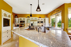 Farm house interior. Luxury kitchen room with big island and gra Royalty Free Stock Photos