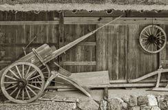 Farm house. Old wooden wheelbarrow in farm house. Autumn harvest background Royalty Free Stock Photo