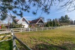 Farm house and paddock Stock Photos