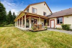 Farm house with patio area. American farm house exterior. House with patio area stock photos