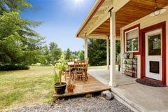 Farm house with patio area. American farm house exterior. House with patio area royalty free stock photography