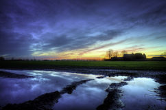 Farm house and puddle Stock Image