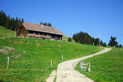 Farm house. SORENBERG, SWITZERLAND - CIRCA AUGUST 2015 Farm house on the slope of mount in mountain area in Switzerland stock photos