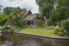 The farm house stands between the channels in the Dutch village of Giethoorn, Netherlands. Royalty Free Stock Photography