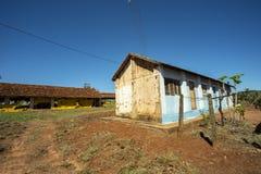 Farm house. Very simple house on a chicken farm. Red earth farm house. Brazil. Farm house. Very simple house on a chicken farm. Red earth farm house. Brazil stock photo