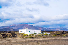 Farm house in volcanic area in Lanzarote. Spain royalty free stock images