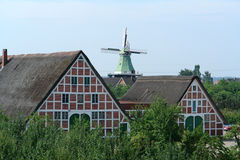 Farm houses. And windmill in northern Germany royalty free stock photos