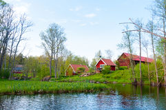 Farm houses on the banks of the river Eman, Sweden Royalty Free Stock Photo