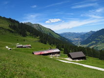 Farm houses and distant view of Gstaad Stock Images