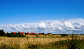 Farm Houses and Fields. View of tranquil farms and fields somewhere in Europe, Lithuania Royalty Free Stock Photography