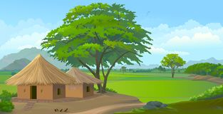 Farm huts in the middle of the meadows. Peaceful settlements of clay houses in the middle of the meadows Stock Image