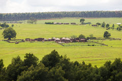 Farm huts. Round african farm rondavels in the hills Royalty Free Stock Photos