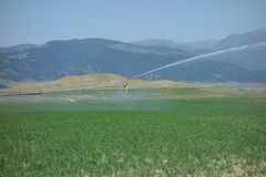 A farm irrigation system at work in idaho Stock Photos