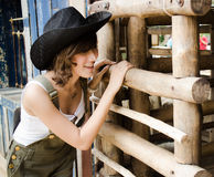 Farm lady. Looking into a sheep cage Royalty Free Stock Photography
