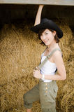 Farm lady. Portrait of a farm lady in front of hay stack Stock Photography