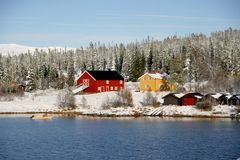 Farm by lake. Farm by a lake in a Norwegian mountain area Stock Photography