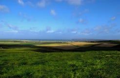 Farm land near Sea stock photos