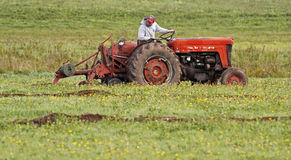 Farm land plough field plow tractor Stock Image