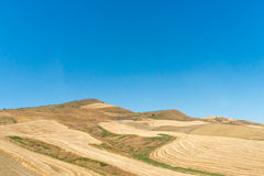 The farm land of Sicily under blue sky Royalty Free Stock Photo