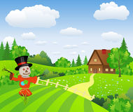 Farm landscape with cartoon scarecrow Royalty Free Stock Image