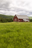 Farm landscape with red barn Stock Photos