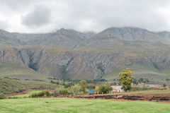 Farm landscape with a vehicle visible on the Swartberg Pass Stock Photo