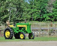 Farm Life. John Deere tractor Still Going Strong on the farm Royalty Free Stock Images