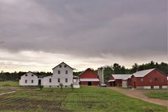 Farm located in Franklin County, upstate New York, United States. Rural farm with surrounding green vegetation located in Franklin County, upstate New York Stock Photos