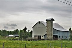 Farm located in Franklin County, upstate New York, United States. Rural farm with surrounding green vegetation located in Franklin County, upstate New York Royalty Free Stock Photography