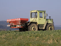 Farm machine. Green german farm machine with pickup stock image