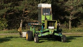 Farm machine on the edge of a farm field stock photos