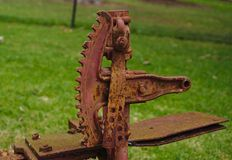 Farm machinery gear full of rust stock photography