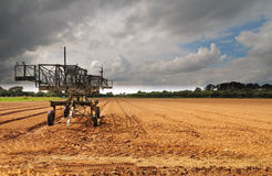 Farm Machinery parked in a newly tilled field Royalty Free Stock Photography
