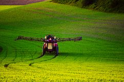 Farm machinery spraying insecticide Stock Photos
