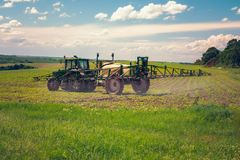 Farm machinery spraying insecticide to the agricultural field Stock Photography