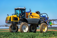 Farm machinery spraying insecticide. Royalty Free Stock Photo
