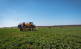 Farm machinery spraying insecticide. Stock Photography