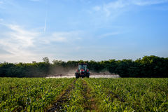 Farm machinery spraying insecticide. Stock Images