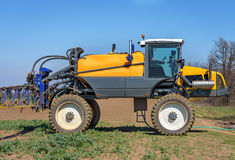 Farm machinery spraying insecticide. Stock Image