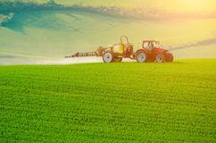 Farm machinery spraying insecticide Royalty Free Stock Images