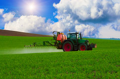 Farm machinery spraying insecticide. To the green field, agricultural natural seasonal spring background Stock Photography