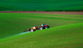 Farm machinery spraying insecticide Stock Images