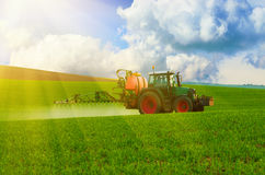 Farm machinery spraying insecticide Stock Photo
